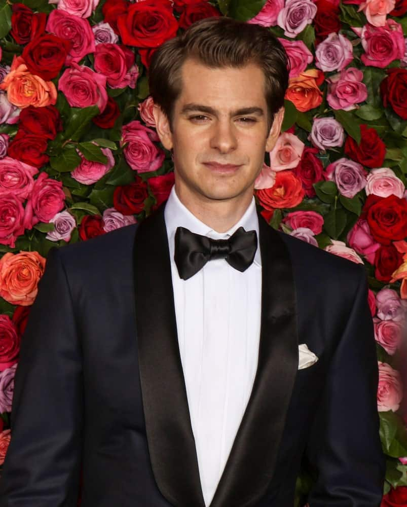 Andrew Garfield is oozing with charm in this classic black suit along with his brunette hair that's neatly brushed during the 72nd Annual Tony Awards at Radio City Music Hall on June 10, 2018.