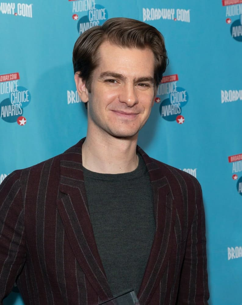 The actor arrived at the Broadway.com Audience Choice Awards celebration on May 24, 2018 with a neat side-swept hairstyle complemented with an edgy striped suit.