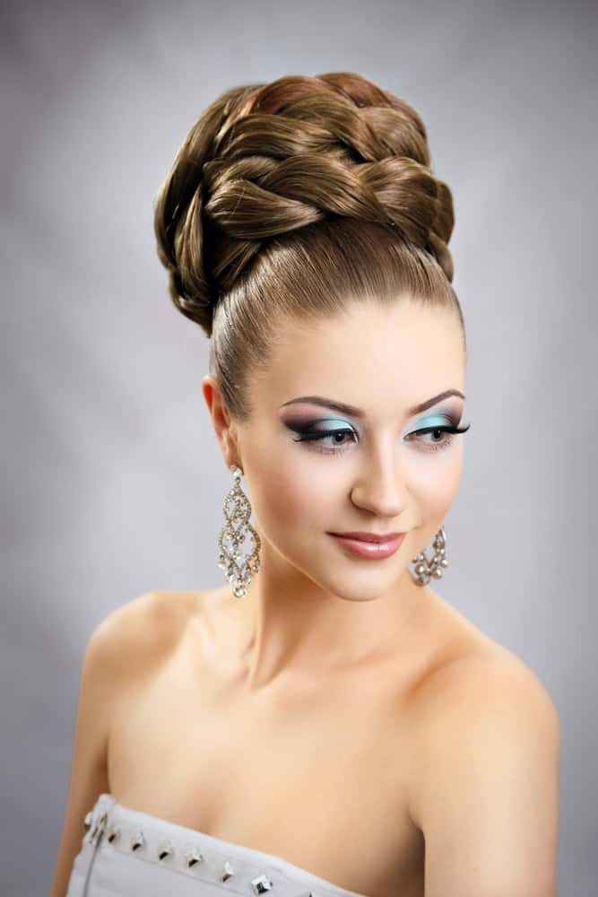 Make your big top knot unique by wrapping the braided locks, a style that has been a favorite amongst the classy brides.