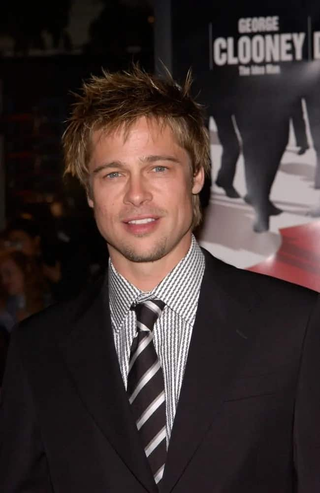 Brad Pitt was at the premiere of his 2001 movie, Ocean's Eleven wearing a black suit and patterned tie to complement his highlighted spiky hair.