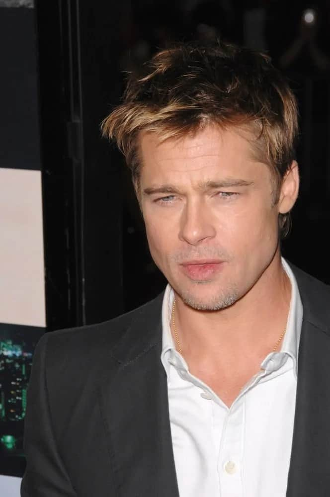 Brad Pitt's sexy and smoldering eyes were on full display with his short and tousled hair with blond tips at the Los Angeles premiere of his movie