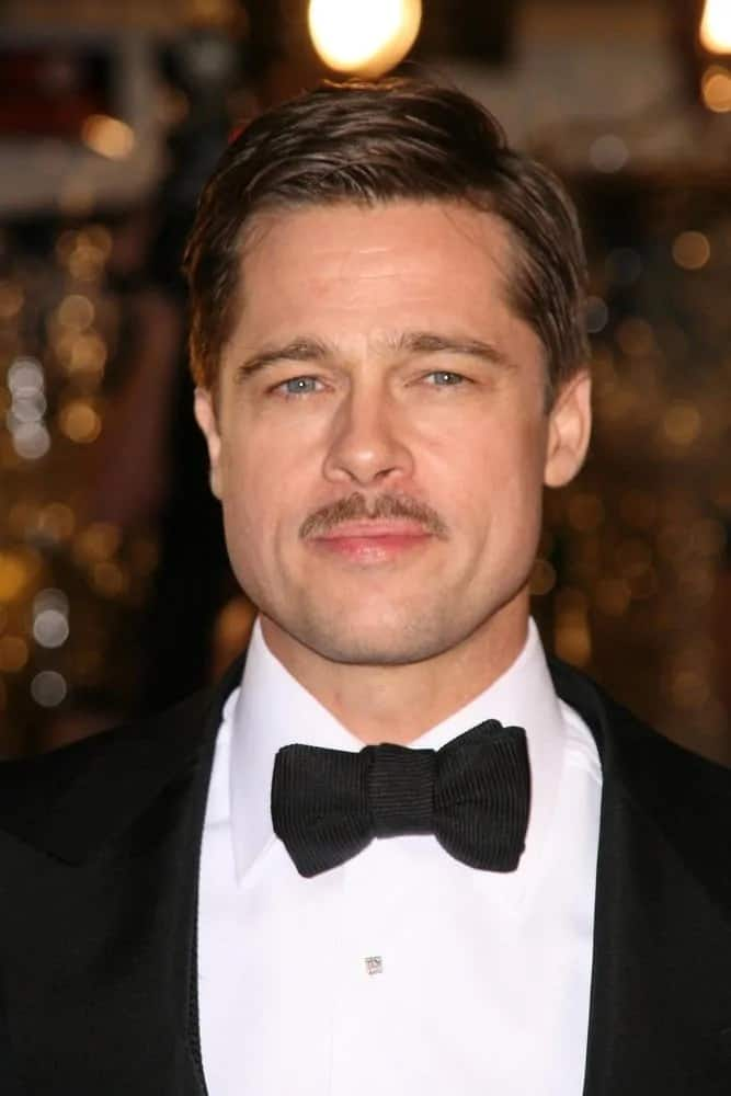 Brad Pitt paired his classic tuxedo with a thin mustache and a side-parted slick short hairstyle at the 2008 Premiere of 'The Curious Case of Benjamin Button' in Los Angeles.