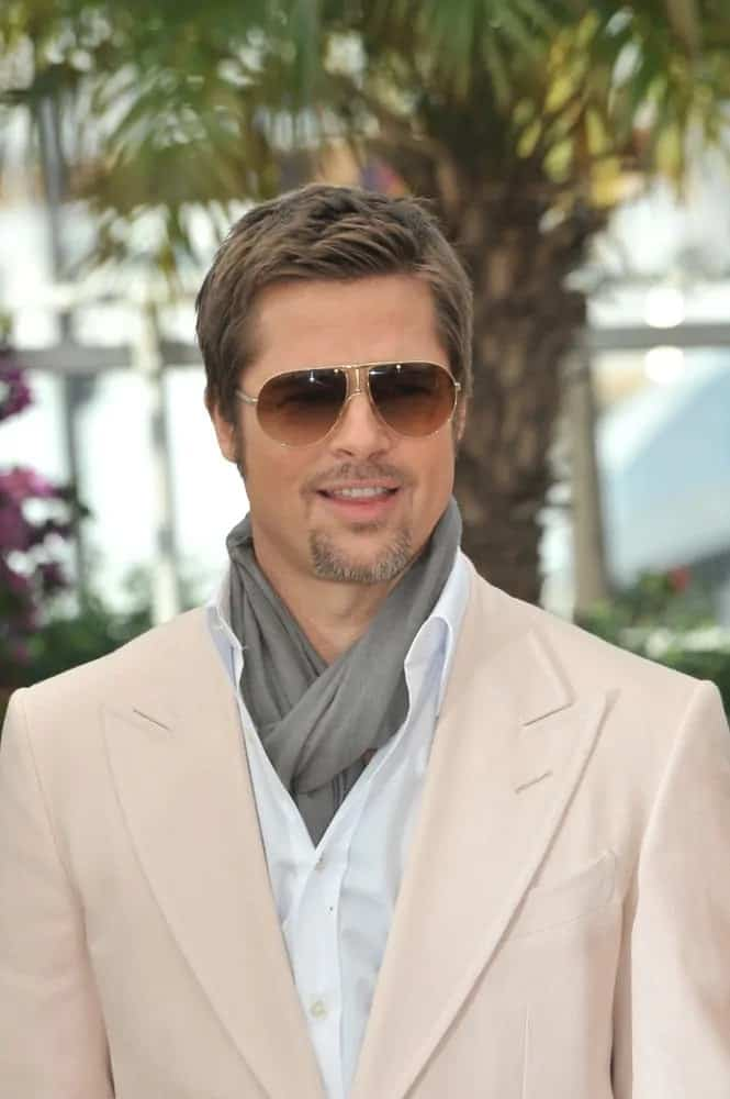 Brad Pitt was at the photocall for his movie back in 2009 wearing a classy outfit to go with his short and spiky crew cut hairstyle and aviator sunglasses.