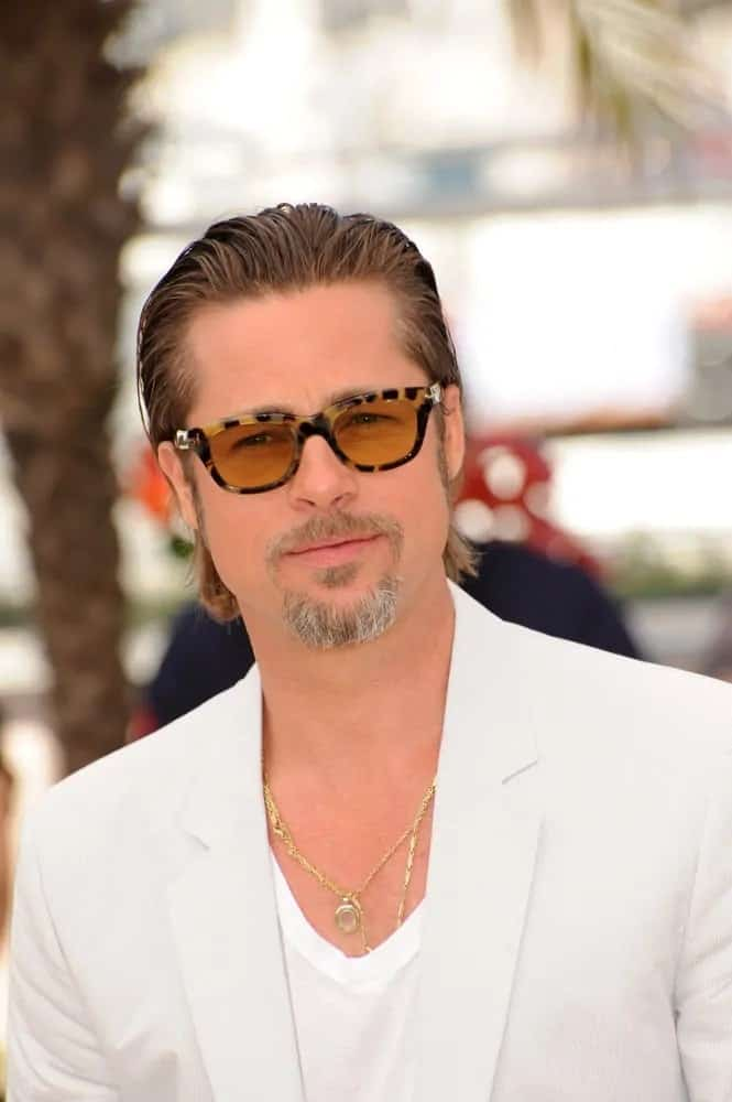 Brad Pitt sported a smooth and sexy vintage look with his all-white outfit slicked back long hair at the photocall for his new movie