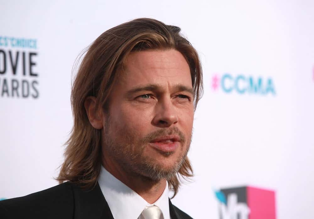 Brad Pitt attended the Critic's Choice Movie Awards back in January 12, 2012 in Hollywood, CA. He wore a classy suit and tie that perfectly complements his gorgeous highlighted long hairstyle and trimmed beard.