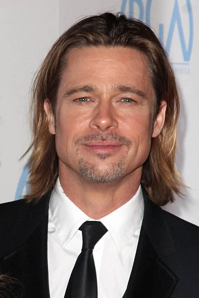 Brad Pitt wore a feathered look on his long center-parted hairstyle with highlights at the 23rd Annual Producers Guild Awards, Beverly Hilton, Beverly Hills back in 2012.
