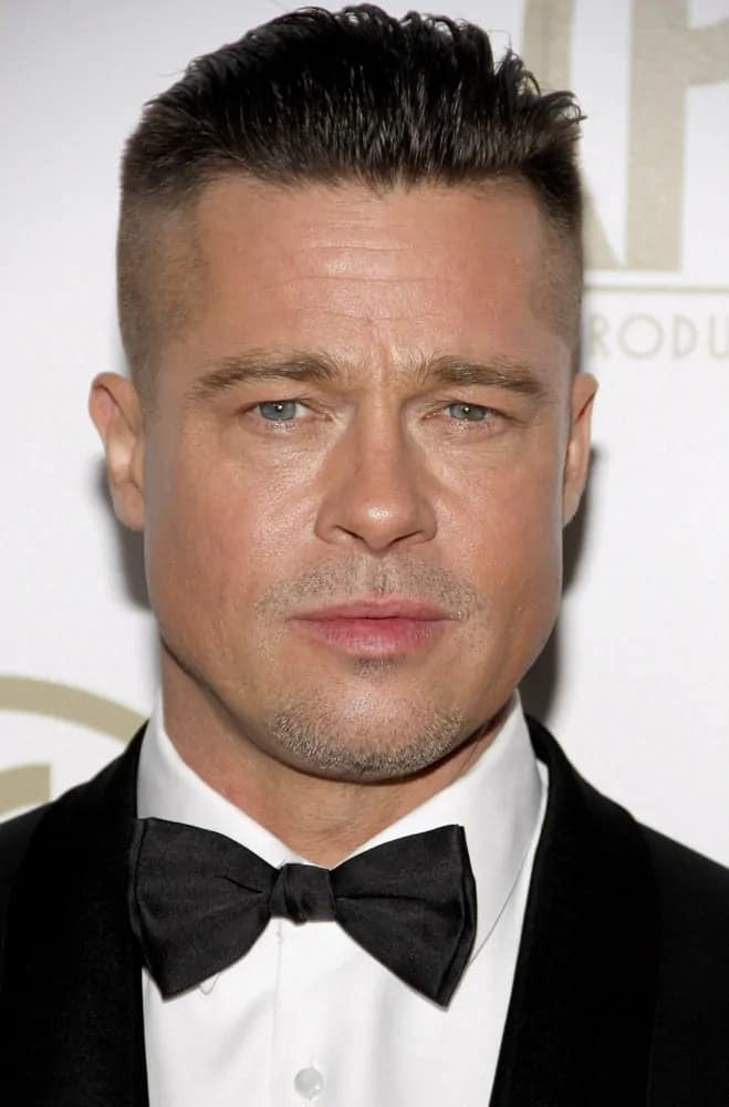 Brad Pitt looked fierce with his slicked-back undercut hairstyle at the 25th Annual Producers Guild Awards held at the Beverly Hilton Hotel in Los Angeles on January 19, 2014 in Los Angeles, California.