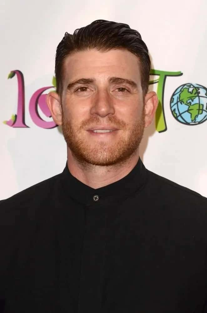 Bryan Greenberg wore a pure black outfit with his slick brushed back hair and trimmed beard at the