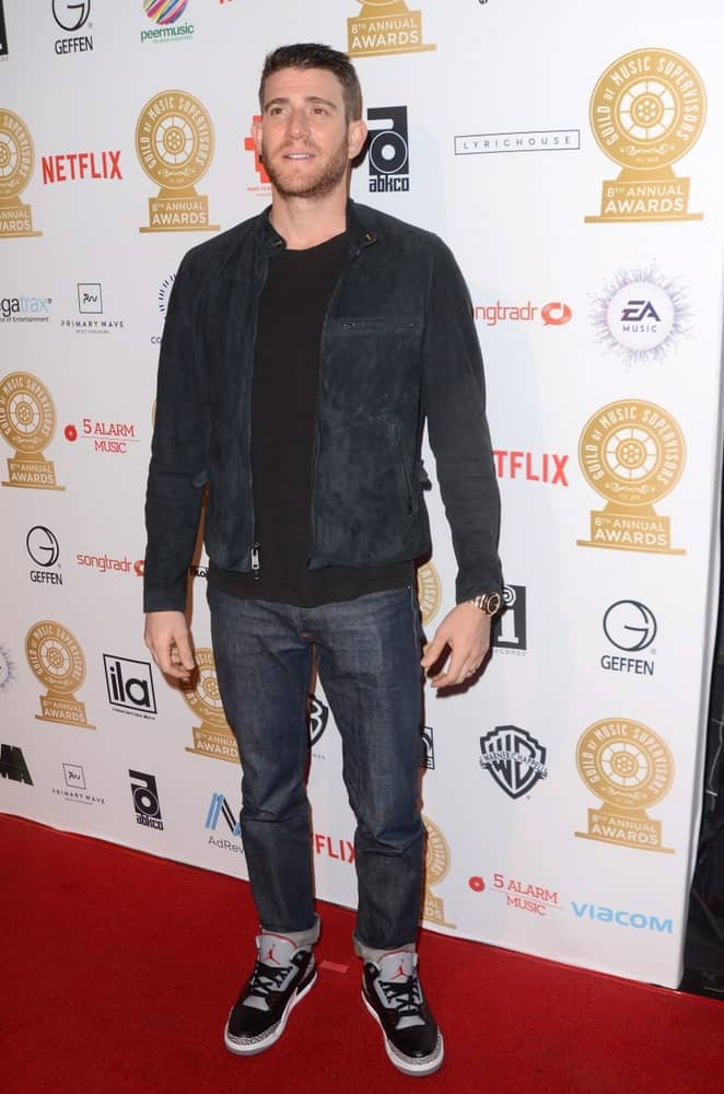 Bryan Greenberg sported a short fade haircut with a trimmed beard at the Guild of Music Supervisors Awards at The Theatre last February 8, 2018 in Los Angeles, CA. He wore a casual outfit with his Jordan sneakers.