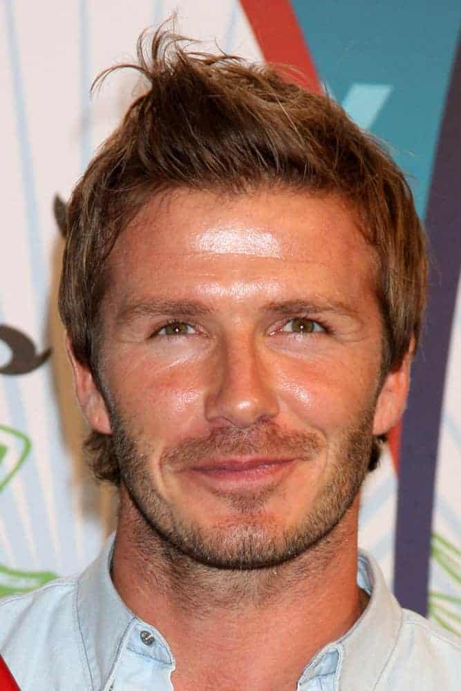 David Beckham styled his elongated hair with an outgrown temple and nape haircut as well as some quiff at the front during the 2010 Teen Choice Awards at Gibson Ampitheater at Universal on August 8, 2010 in Los Angeles, CA.