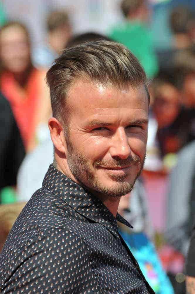 David Beckham paired his taper cut hairstyle with a bearded look during first annual Nickelodeon Kids Choice Sports Awards at Pauley Pavilion, UCLA in 2014.