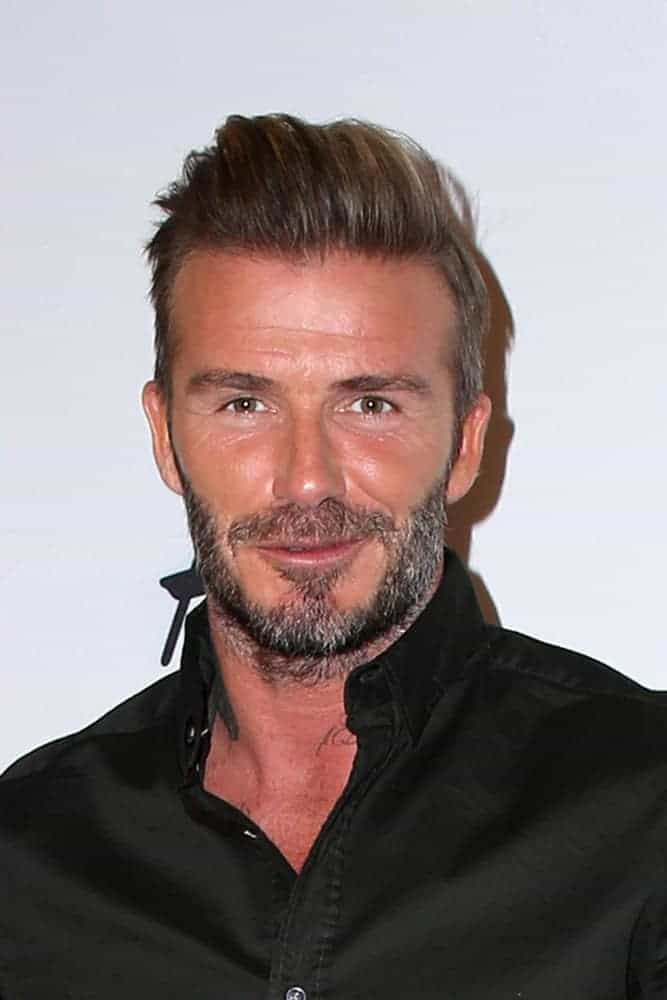 David Beckham looked neat and classy with a pompadour hairstyle that's slicked back at the H&M Modern Essentials Campaign Launch at the H&M Store on September 26, 2016 in Los Angeles, CA.