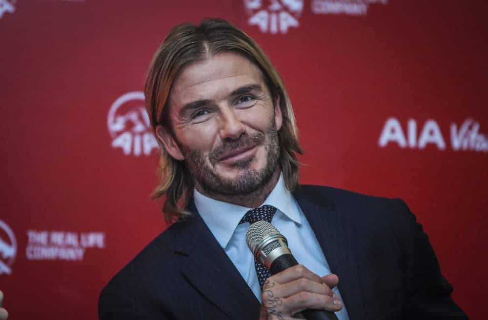 David Beckham pulls off the long hair look with middle parting at the AIA Vitality Healthy Living Tour on September 22, 2017, Kuala Lumpur Malaysia.