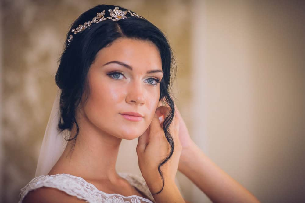 Side-part wedding hairstyle photo example.