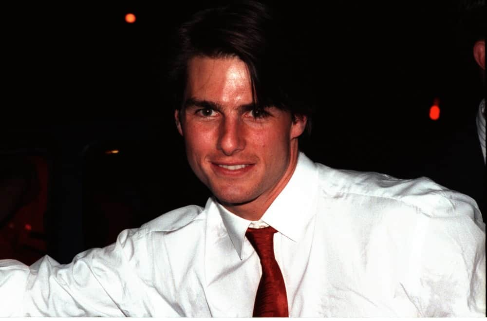 Tom Cruise looked young and fresh in this October 11, 1993 photo when he was leaving Spago Restaurant in Los Angeles. He was wearing a white button-down shirt with his long center-parted hairstyle.