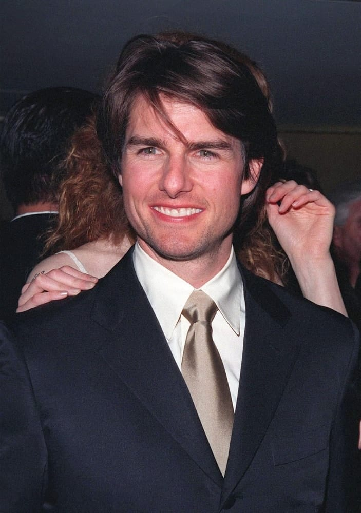 Actor Tom Cruise was practically glowing with pride at the Beverly Hilton Hotel where he was honored with the 1998 John Huston Award by the Artists Rights Foundation. He wore a dark suit with his long side-swept hairstyle.