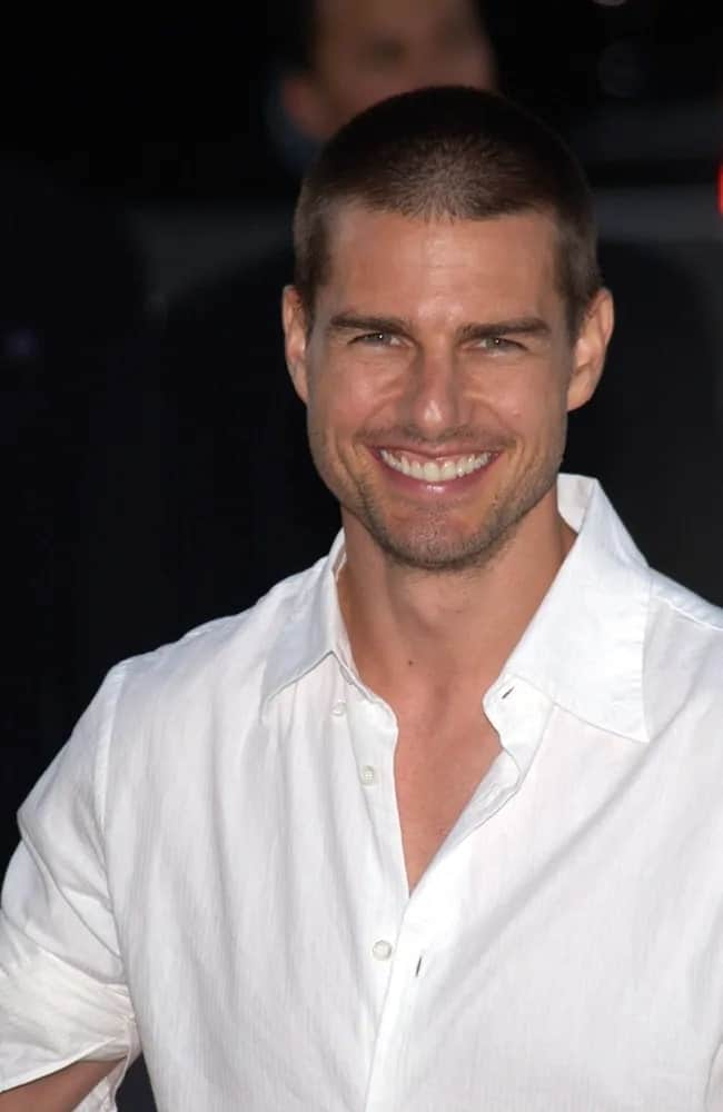 Tom Cruise wore a buzz cut hairstyle with his white button-down shirt at the Los Angeles premiere of