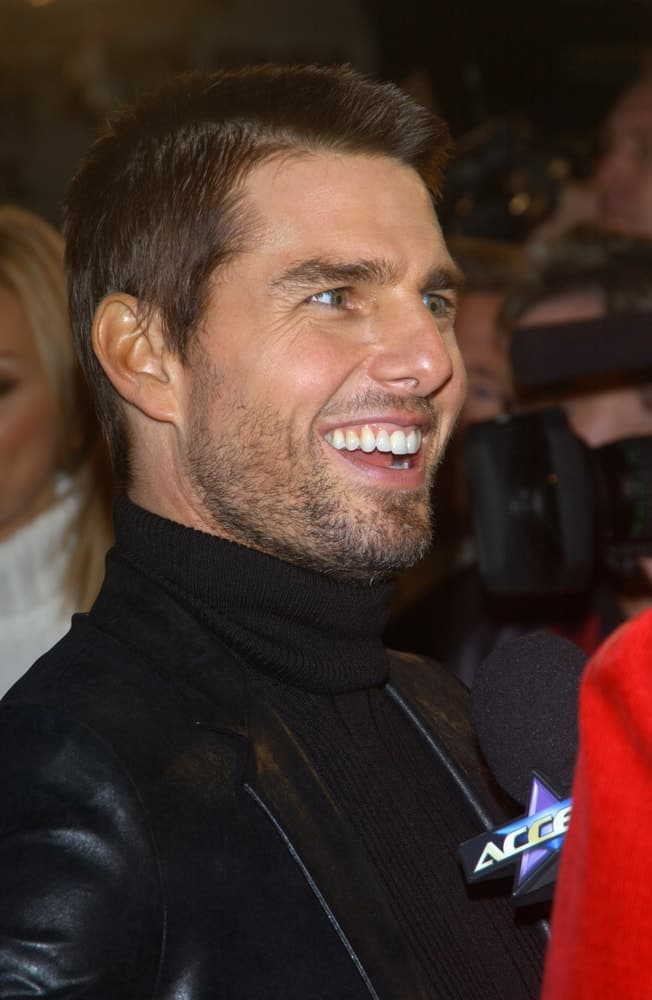 Tom Cruise was at the Los Angeles premiere of his new movie The Last Samurai back in December 1, 2003. He wore a black turtle neck and leather jacket with his crew cut hairstyle and trimmed beard.