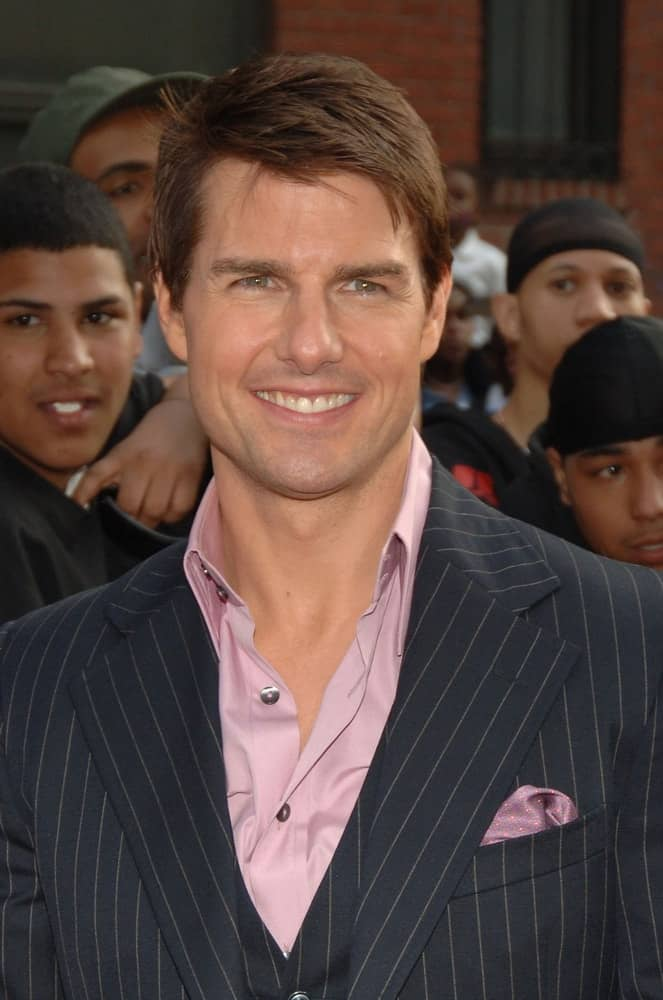Tom Cruise's iconic brilliant smile was complemented by his short side-parted brown hairstyle at the MISSION IMPOSSIBLE III Premiere in Harlem, New York back in May 03, 2006.