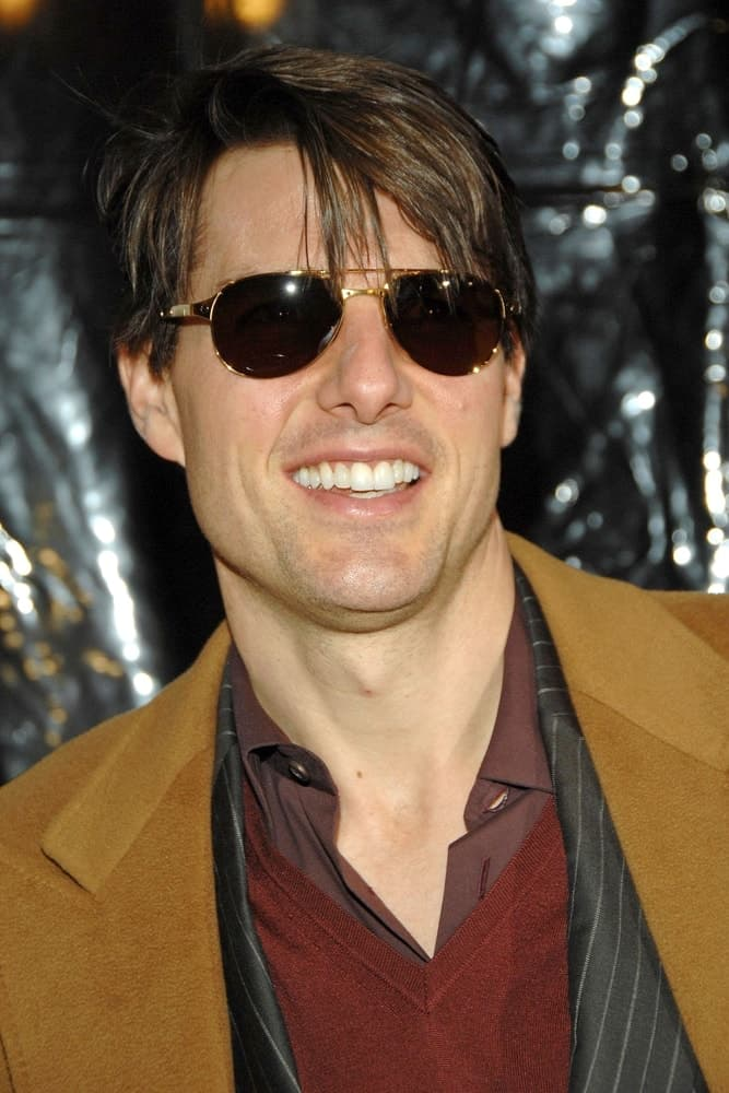 Tom Cruise was at the I AM LEGEND Premiere at Madison Square Garden in New York back in December 11, 2007 wearing a tan suit to pair his highlighted and tousled side-swept hair.