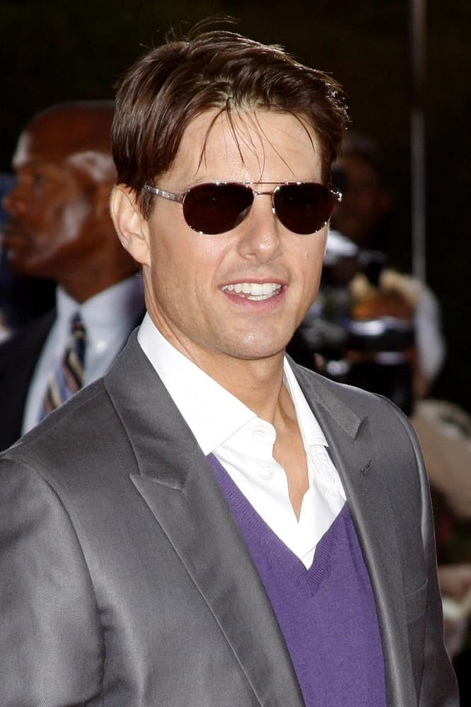 Tom Cruise opted for a slick side-parted hairstyle to pair with his gray suit at the Los Angeles premiere of 'Tropic Thunder' held at the Mann Village Theater in Westwood back in August 11, 2008.