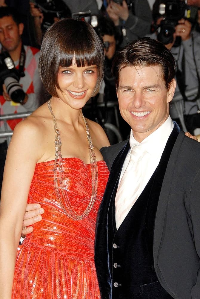 Katie Holmes and Tom Cruise were at the Annual Opening Night Gala of Superheroes Fashion and Fantasy, Metropolitan Museum of Art Costume Institute back in May 05, 2008. Cruise wore a gray suit with his slick side-parted hairstyle.