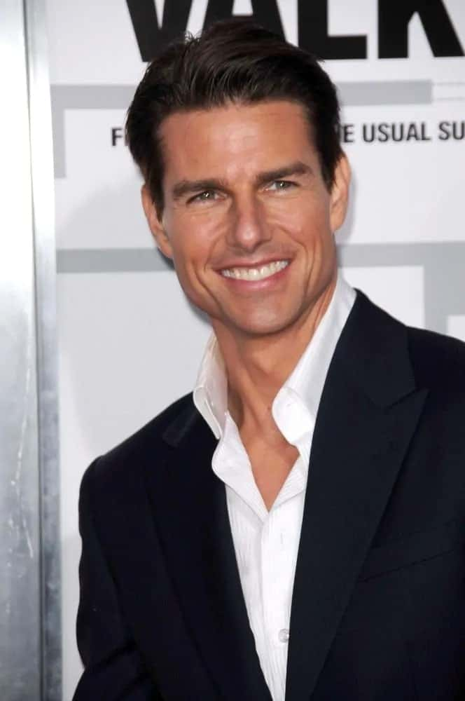 Tom Cruise had a slicked back hairstyle with a slight pompadour look that elevated the class factor of his suit and shirt outfit during the LA premiere of