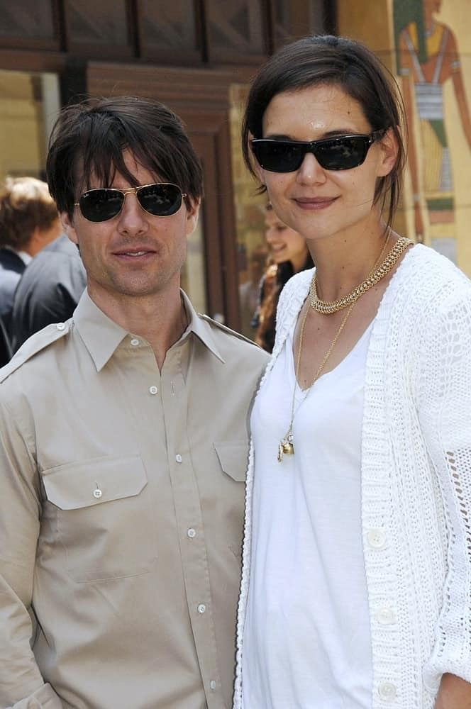 Tom Cruise and wife Katie Holmes were at the induction ceremony for Star on the Hollywood Walk of Fame Ceremony for Cameron Diaz back in June 22, 2009. Cruise wore sunglasses that went well with his long tousled bangs.
