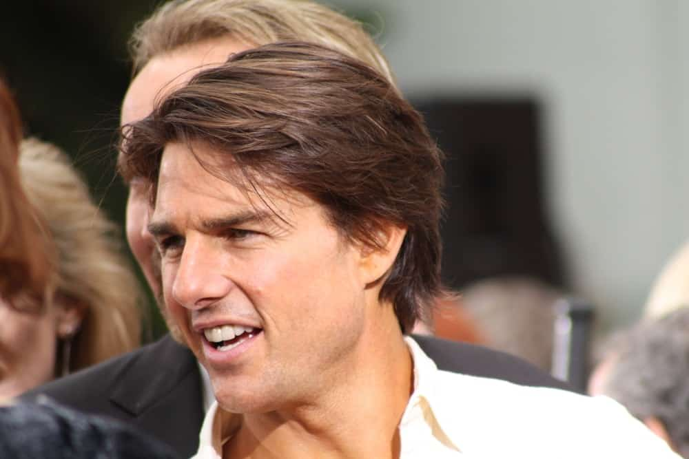 Actor Tom Cruise was at the ceremony where Jerry Bruckheimer was immortalized putting his hand/footprints in cement in Grauman's Chinese Theatre last May 17, 2010. He wore a button-down shirt with his long highlighted hair.