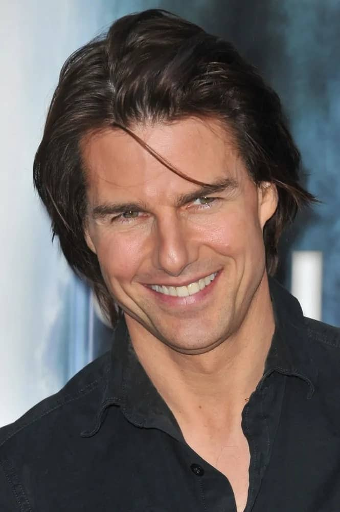 Tom Cruise pulled off a sexy long and center-parted hairstyle with bangs at the Los Angeles premiere of