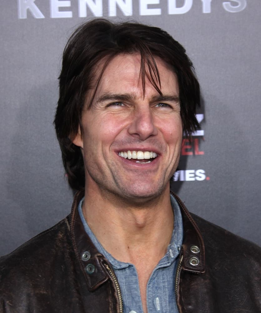 Tom Cruise went with a more casual long and tousled hairstyle incorporated with bangs when he attended the