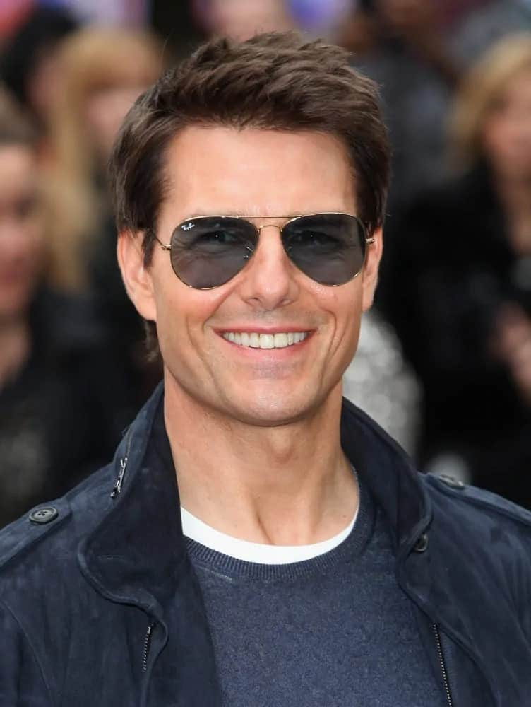 Tom Cruise went with a spiky highlighted hairstyle that complemented his casual outfit at the