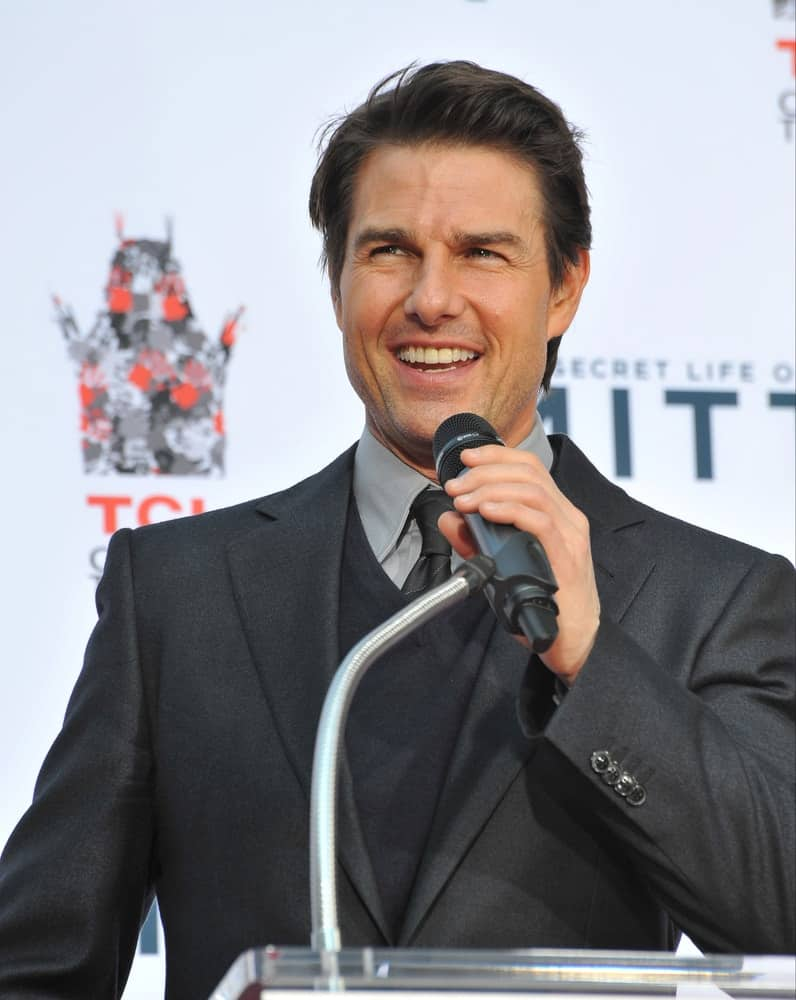 Back in December 3, 2013, Tom Cruise was at the TCL Chinese Theatre where actor Ben Stiller had his hand & footprints set in cement. He wore a classy charcoal suit complemented by his gorgeous smile and short side-parted hairstyle.