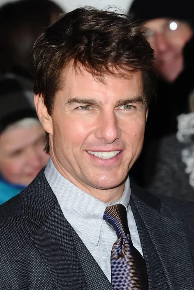 Tom Cruise made an appearance with his dark gray suit and short tousled hairstyle for The Oblivion UK Premiere at the BFI Imax, London in 2013.