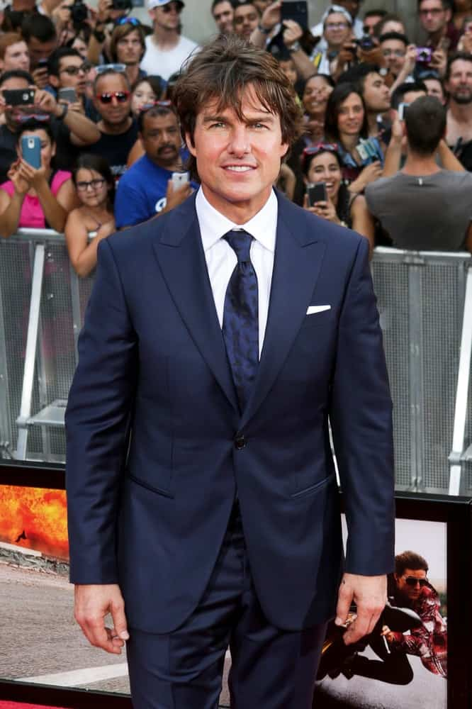 Actor Tom Cruise attended the US Premiere of 'Mission: Impossible - Rogue Nation' in Times Square back in July 27, 2015 in New York City. His long flowing hair was tousled and highlighted complementing his handsome features.