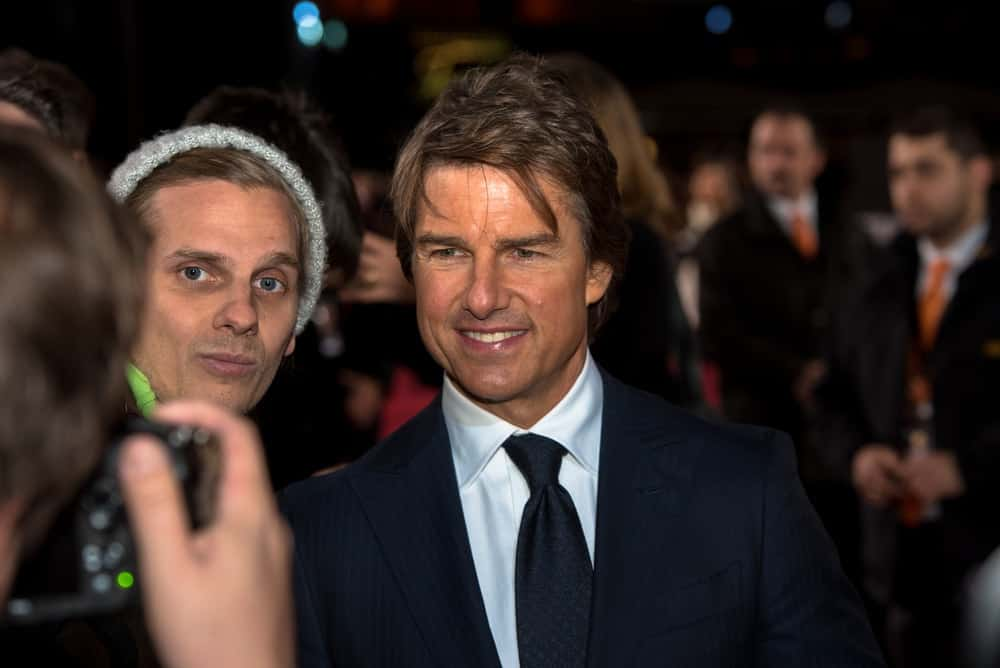 Tom Cruise was at the German premiere of Jack Reacher at Sony Center last October 21, 2016 in Berlin, Germany. He paired his classy pin-striped suit with a side-parted short tousled hair.