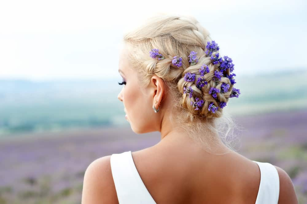 Wedding hairstyle with flowers.
