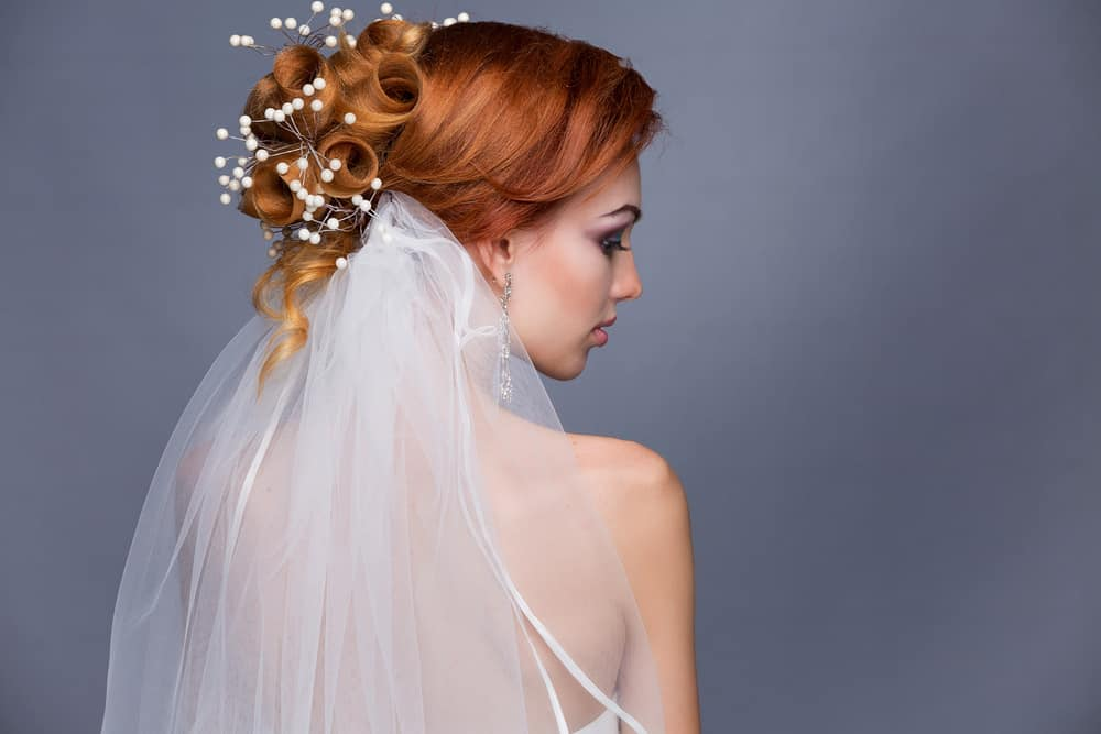 Wedding upstyle with veil - woman with red hair.
