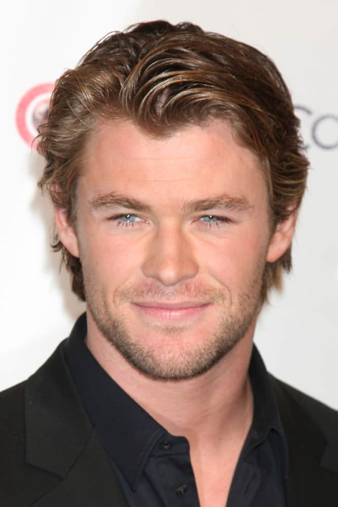 Chris Hemsworth in the CinemaCon Convention Awards Gala Press Room in 2010 wearing his side-swiped medium-length hair.
