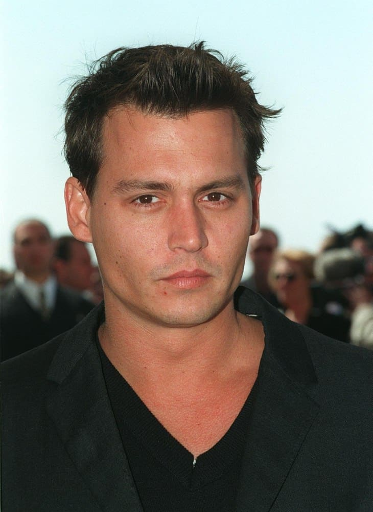 Fresh-faced Johnny Depp looked dashing in a short haircut with a quiff during the 1997 Cannes Film Festival.