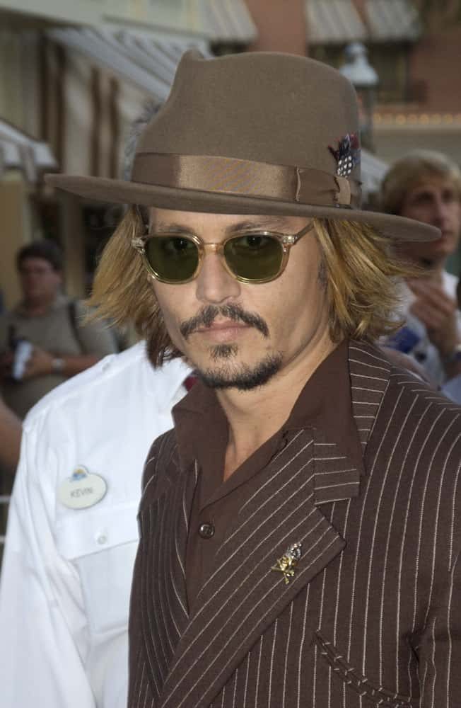 Johnny Depp showed up with bleached medium-length hair and a matching sunglasses and brooch during the world premiere of his new movie