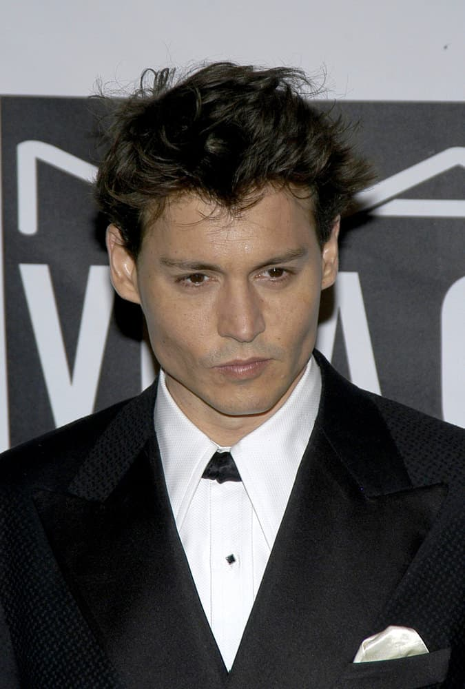 Johnny Depp looked dapper in a short haircut with tousled short spikes at the Actor's Fund of America THAT'S ENTERTAINMENT gala, New York, October 30, 2004.