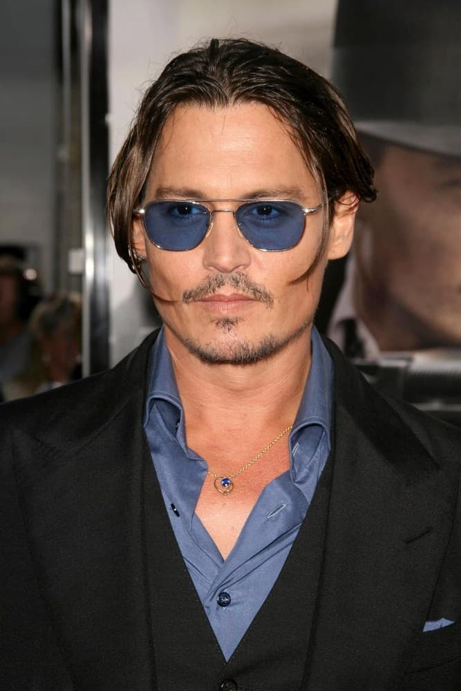"Johnny Depp tied his hair in a bun during the Los Angeles Premiere of ""Public Enemies"" held at Mann Village, Westwood, CA in 2009."