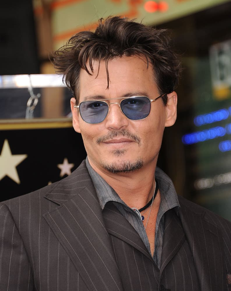 Johnny Depp showed up with his stylish messy hairstyle as he arrived to the Walk of Fame Honors Jerry Bruckheimer on June 23, 2013 in Hollywood, CA.