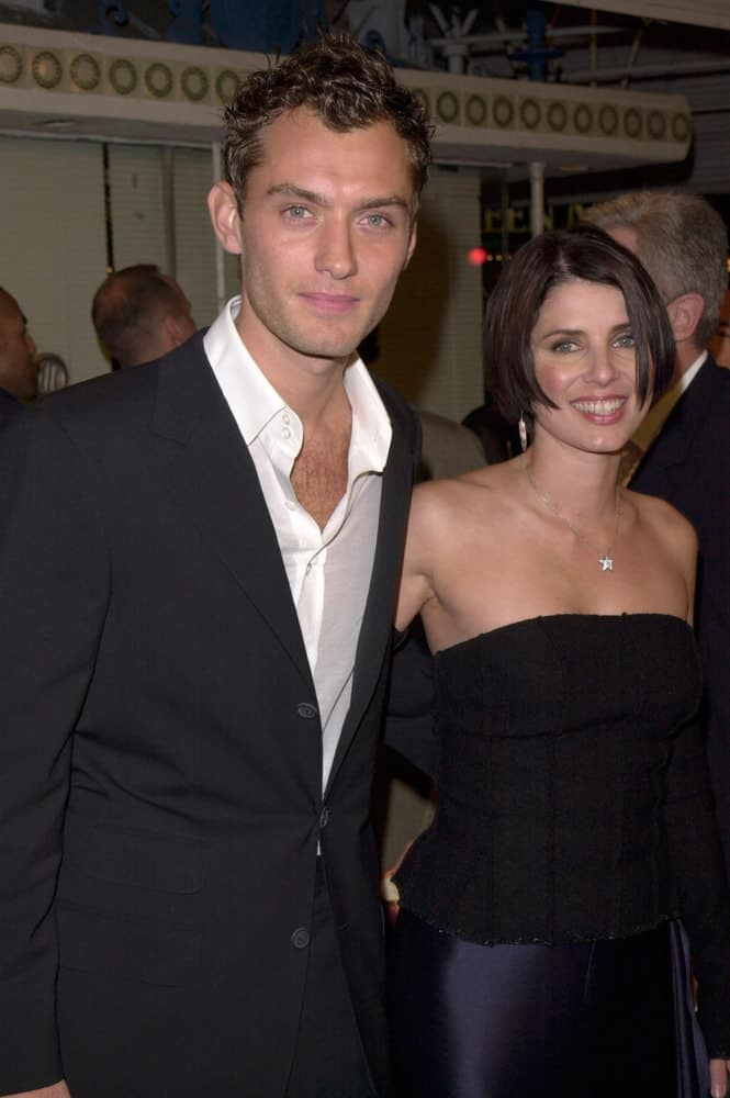 A young Jude Law with short curly hair appeared with his then girlfriend, actress Sadie Frost, at the Los Angeles premiere of his movie