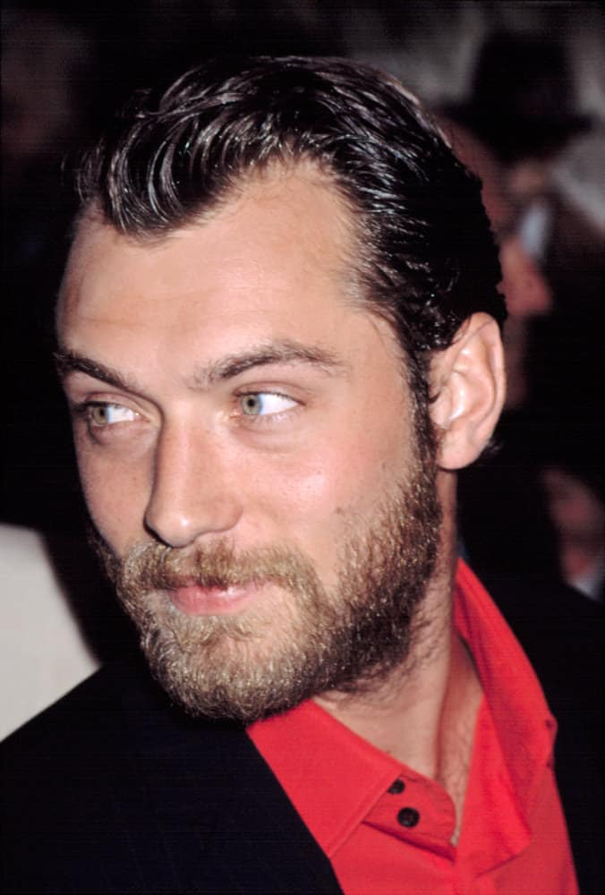 "Jude Law looked ruggedly handsome with dyed black hair and beard during the New York premiere of ""Road to Perdition"" in 2002."