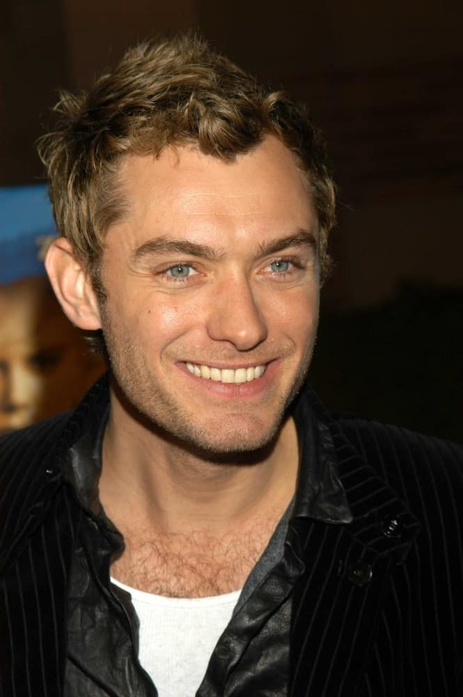 "Jude Law had a short haircut with a sort of messy quiff when he attended the celebration of the words and music of ""Cold Mountain"" at Royce Hall, UCLA on December 08, 2003 in Los Angeles, CA."