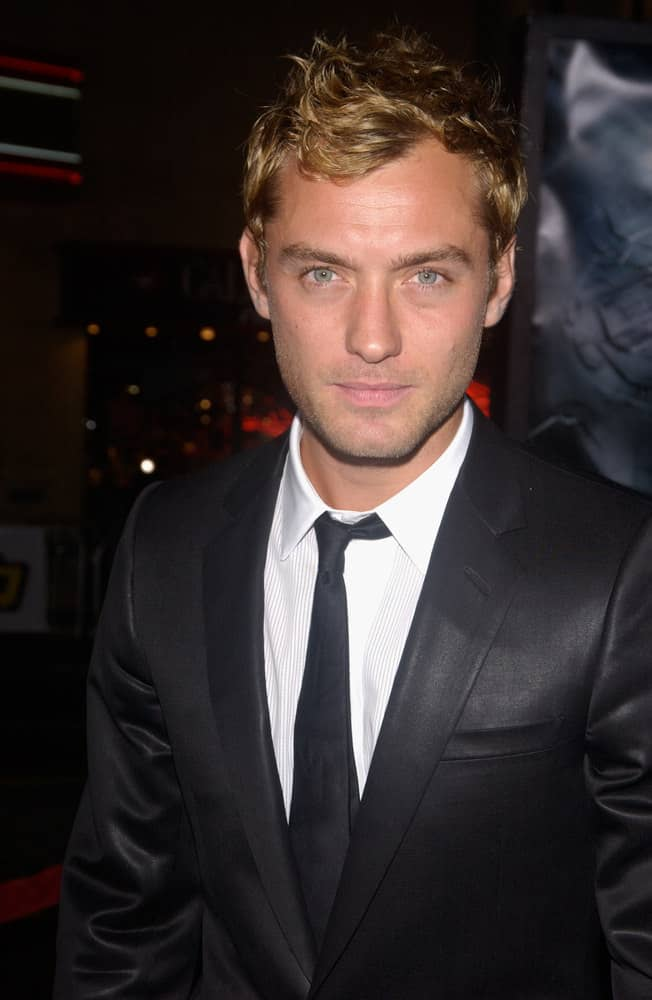 Jude Law looked dashing with golden curls when he attended the world premiere of his movie