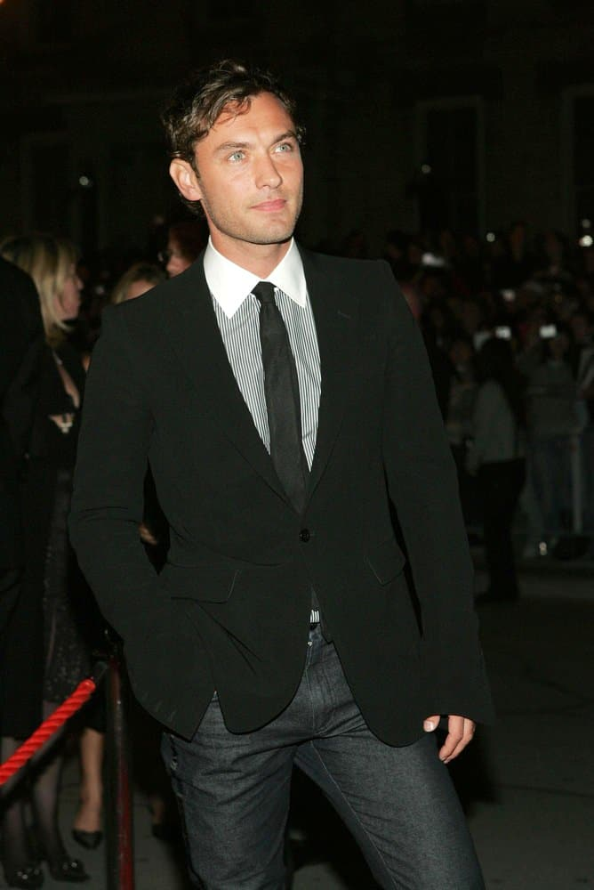 Jude Law wore his signature hairstyle but with dyed black hair at the gala premiere of