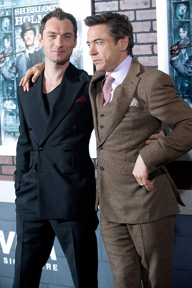 "Jude Law dyed his hair black and posed a photo with co-star Robert Downey Jr for the New York premiere of their movie ""Sherlock Holmes"" in 2009."